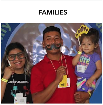 Families - A Hispanic woman, man and young girl with photo booth props