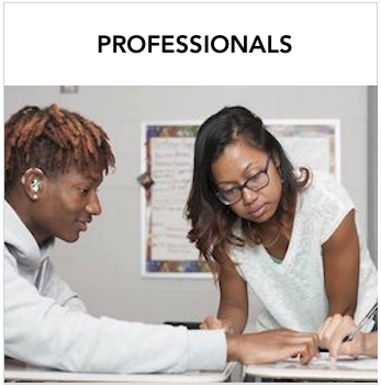 Professionals - A dark skinned woman looking at a paper with a male dark skinned student with hearing aid pointing to the paper.
