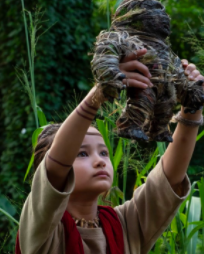 Kaylee Hottle: young Asian American female holding up a doll that looks like Kong