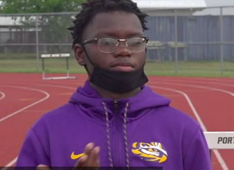 Jarvis Anderson - black male with glasses and purple hoodie jacket