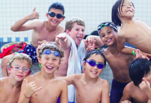 Students posing at the swimming pool